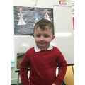 Nursery:  This young man has been kind, helping another child this week!