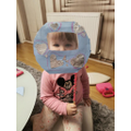 Nursery:  It's Emili in her fabulous space helmet she's made!