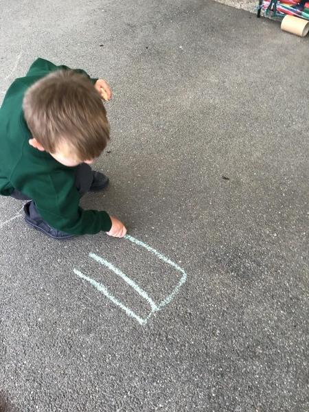 Name writing using chalk on the playgound