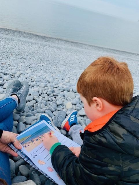 Using his senses at the beach to do his writing