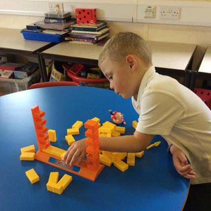 Joshua enjoying building Humpty's Wall