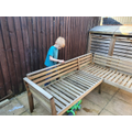 Zak has sanded down a bench before painting it.