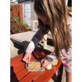 Payton is making her bird feeder.