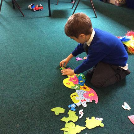 Kaivin enjoying a jigsaw