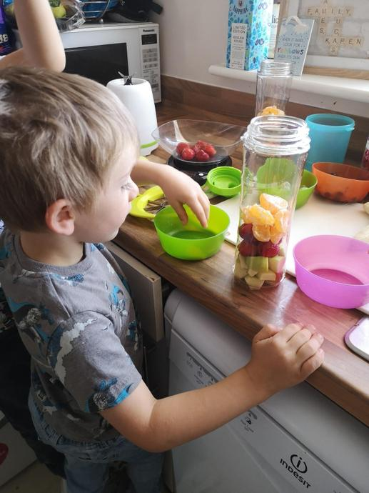 Counting the fruit for the smoothies, yum!