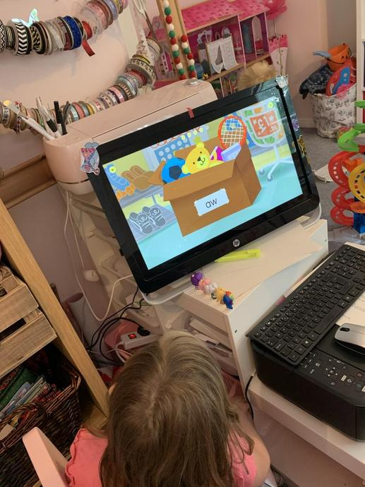 Practising her spelling with some online fun games