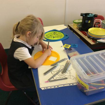 Lia enjoying some art and craft