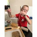 Ashton finished his bird feeder