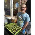 Josh has been helping to plant seeds.