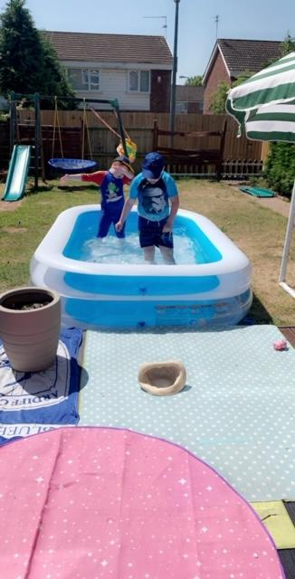 Playing in the paddling pool