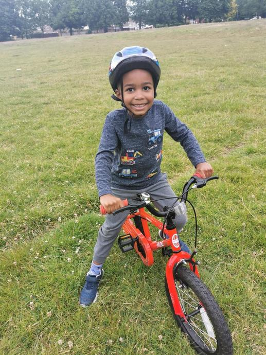 Learning how to ride his bike without stabilisers