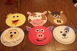 Some examples of Farm Animal Face Masks made from paper plates