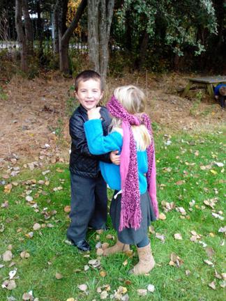Josh getting Lia prepared for hugging her tree.