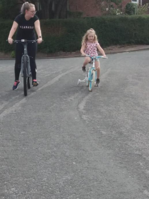 Riding my bike with my sister