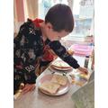 Jacob making a minibeast sandwich