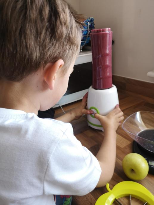 Lucas blending his smoothie.