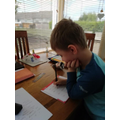 Lucas is working hard on his handwriting.