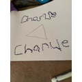 Charlie has been practising his name