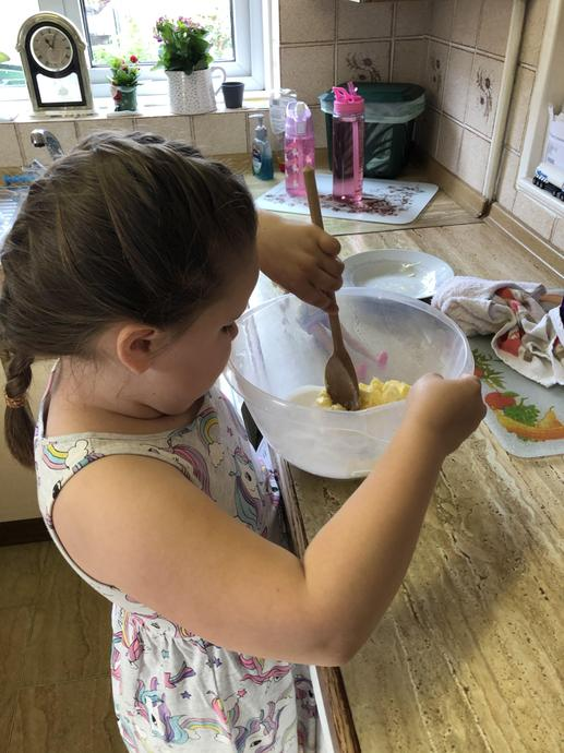 Mixing them together for her recipe.