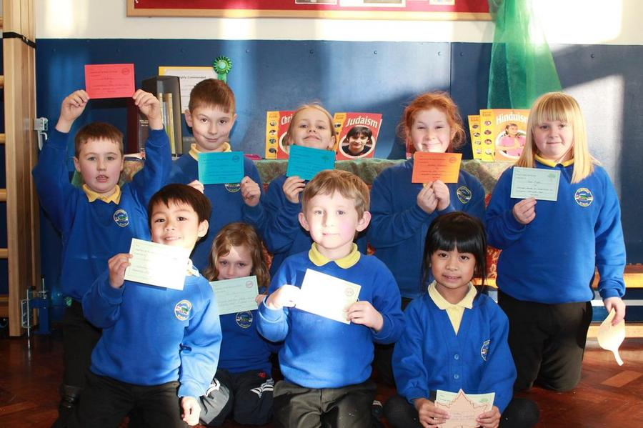 Receiving certificates in Achievement Assembly.