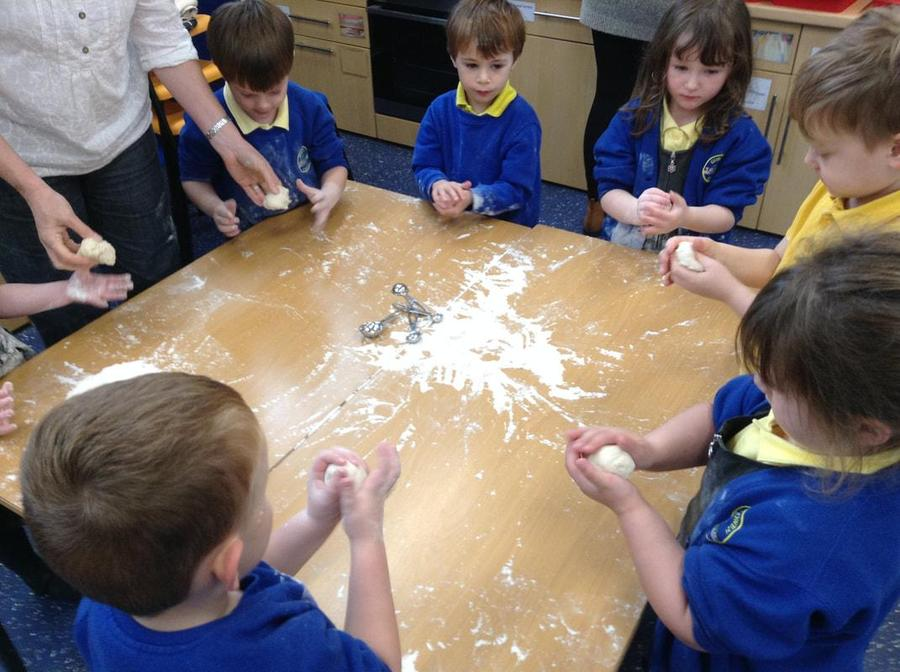 Developing fine motor control by baking bread.