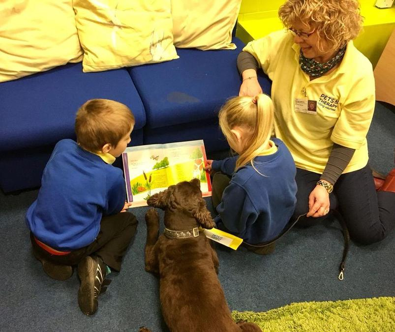 Tom and Jane reading with year 3 children.