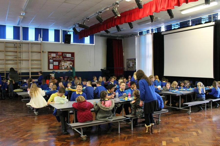 Older children help in the hall by serving