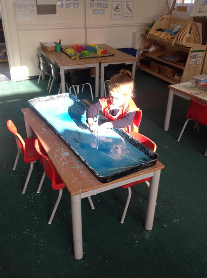 Making marks in cornflour with tools