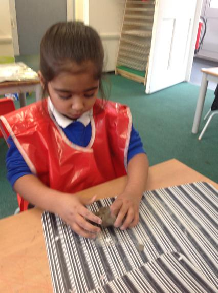 Pinching clay helps children develop a pincer grip