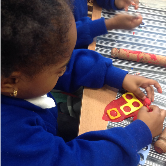 Exploring Numicon shapes in the playdough
