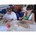 Moulding our coin moulds with clay.