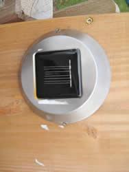 A solar panel provides energy for a light and a little warmth.