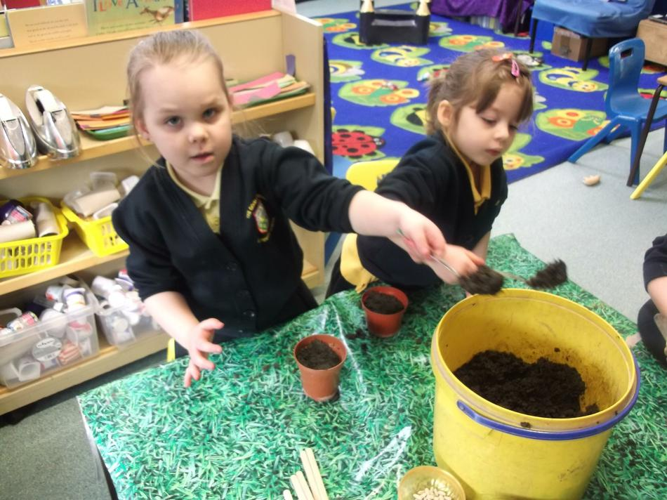 We each filled our plant pot with some soil.