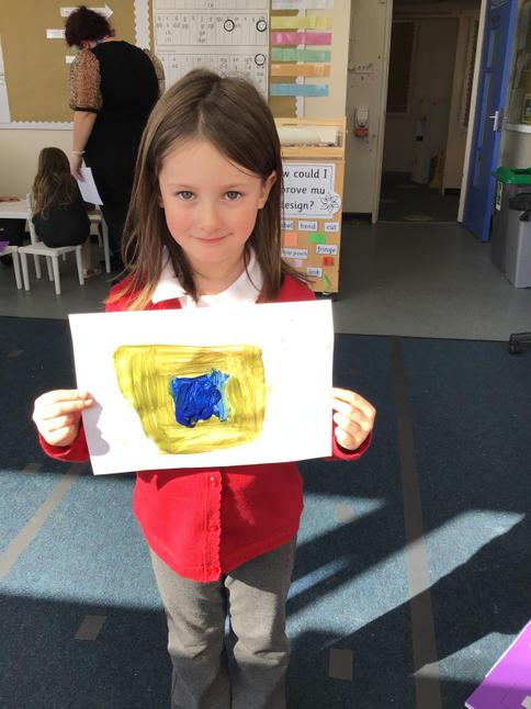 Exploring with the primary colours to make green paint during our Continuous Provision.