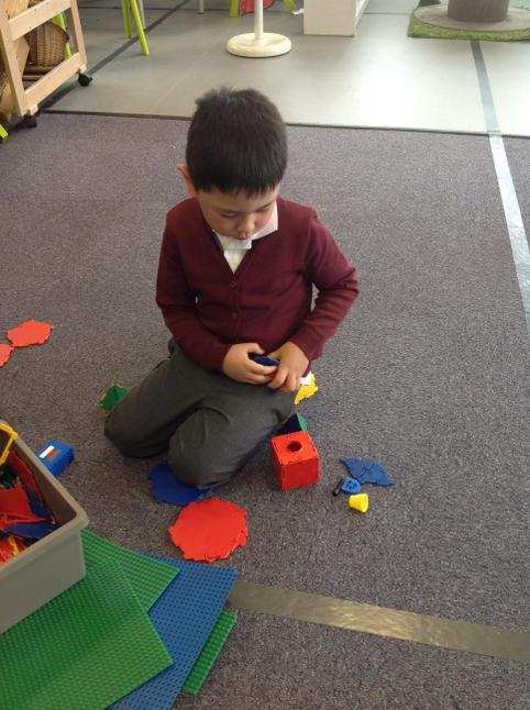 Jenson worked really hard to make shapes with the Knex.