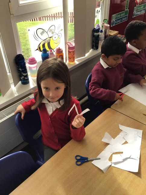 Cutting abstract lines for our Matisse inspired art.