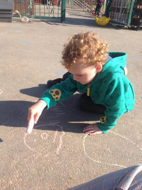 Mark making with chalk in our outdoor area