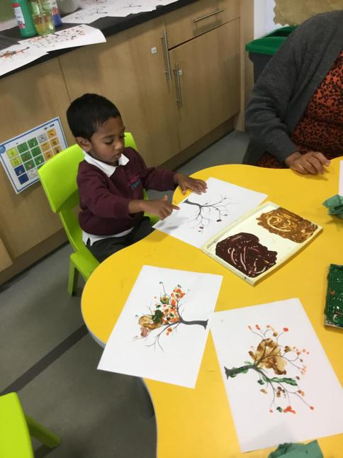 We used Autumal colours and our fingers to create some lovely tree pictures