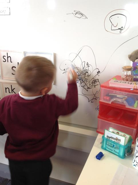 Jaxon showing everyone how to draw spider webs.