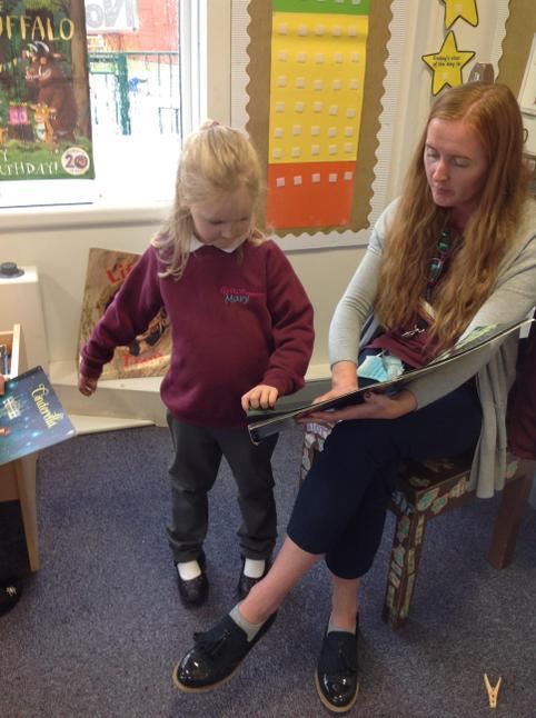 The children love listening to Mrs Clayton's stories!