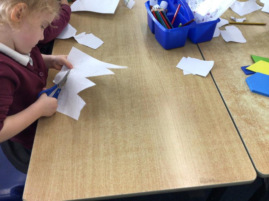 Carefully cutting abstract shapes and lines for our own Matisse inspired art work.