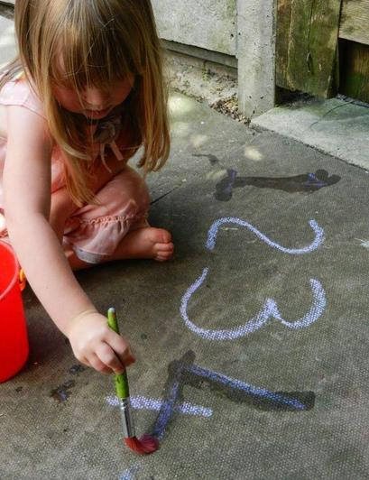 Overwrite using chalk, water and paintbrush