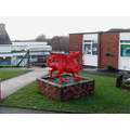 Our proud dragon, welcoming all to school!