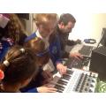 Heather & Eva experimenting on the synthesizer