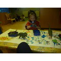 Mark  making with small world dinosaurs