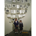 Millie and Sadie stand in front of the printmaking
