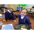 Jenson and Amelia play with the shapes to make fit