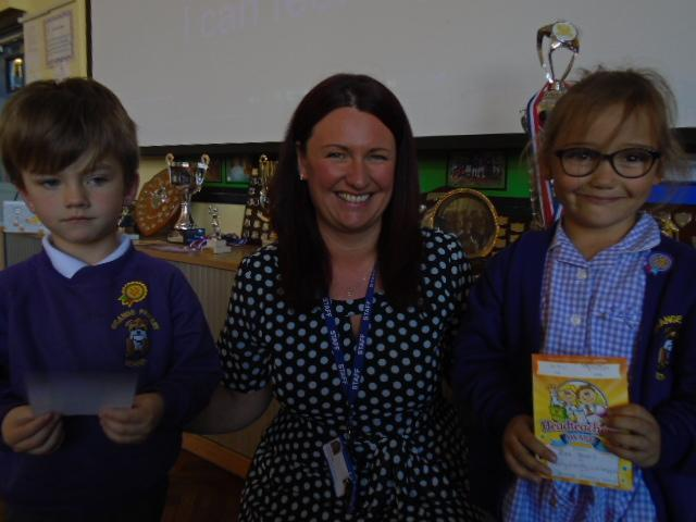 Zoe and Harley receive their award from Mrs Yates