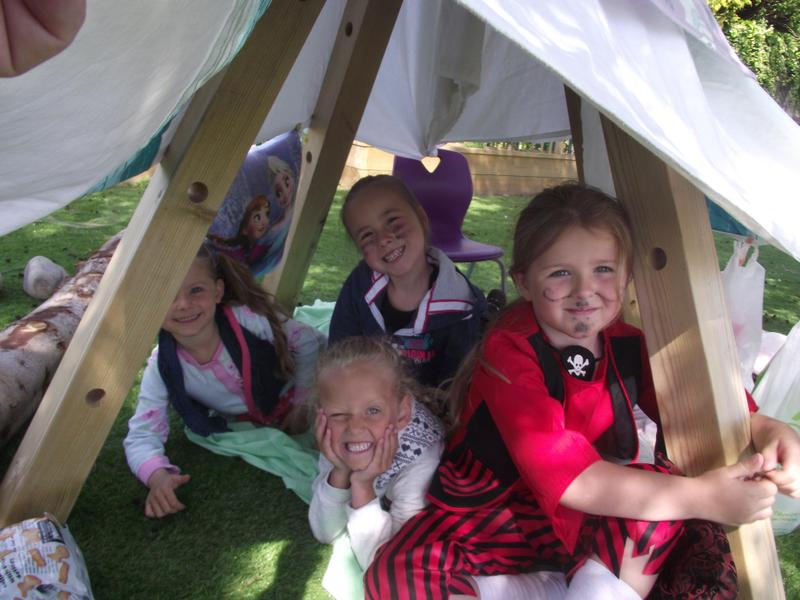 The girls use a wigwam frame to help make theirs!