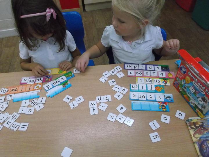 Playing phonic games to help us read and spell.